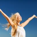 Beautiful Woman Enjoying Summer Outdoors| Health Psychology | Careers in Psychology