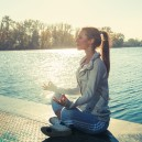 woman meditate on lake