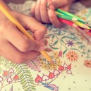 Person Drawing in a Coloring Book for Art Therapy | Careers in Psychology