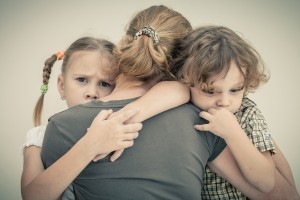 Sad Kids Hugging Mother